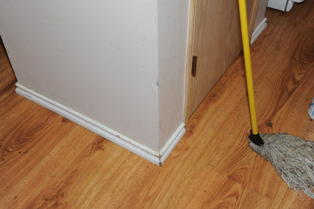 Kitchen, damaged baseboards.