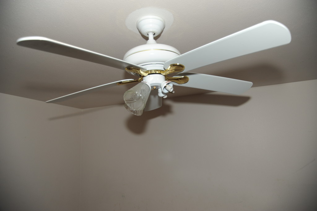 Remove fan, replace with nice light fixture.