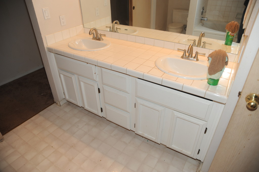 Counter is ok, no water damage under sink.  Recommend fresh paint on cabinet.